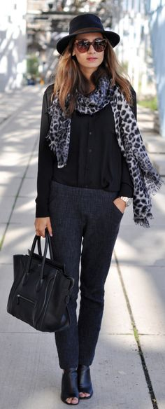 Kelly Elise is wearing a blouse from Percée, jogger trousers from Humanoid, scarf by By Malene Birger, Hat from Carlala Fashion, shoes from Prada and the bag  and sunglasses are from Céline
