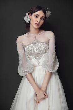 French embroidery bodice, and puff sleeves, hand decorated with seed beads, #Swarovski crystals and pearls. Soft tulle skirt.