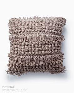 Tassel and Texture Crochet Pillow