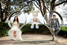 This Disney couple couldn't resist sitting in this Mickey Mouse ears sculpture #Disney #wedding #photography #MickeyMouse