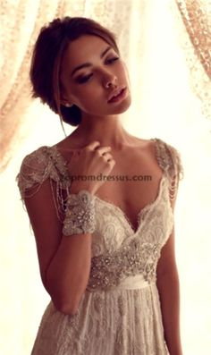vintage wedding dress with sleeves. so beautiful. im so picky I should start dress hunting for my far off in my imagined future wedding dress now!