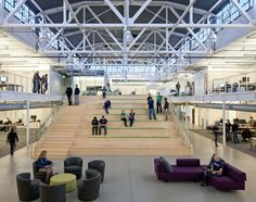 Wide tiered seating with stairs on the side. Could anchor a big open space (Atlassian Offices / Studio Sarah Willmer)