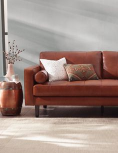 Gorgeous and comfortable. The type of statement-making sofa you can build an entire room around. Impeccably detailed with a thick, block-tufted seat cushion, classic track arms, and tapered block feet. Iconic bolster pillows make the choice simply perfect.