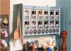 This wall system brings a touch of vintage charm to your kitchen, while basically clearing an entire shelf of your pantry.