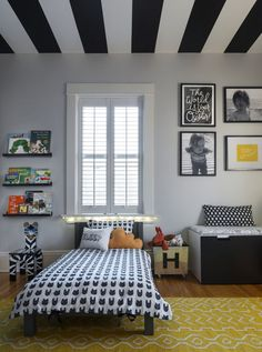 Graphic and Modern Toddler Boy Room with Black and White Striped Ceiling