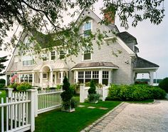 """Double gabled, waterfront, cedar shake """"cottage""""..."""