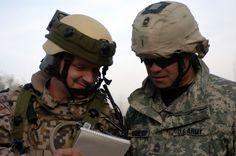 A Latvian Soldier compares notes with a Michigan Army National Guard Soldier at the Joint Multinational Readiness Center in Germany.