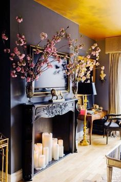 Fireplace facade design with navy blue wall and candles
