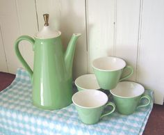 Vintage Green and White Coffee or Tea Pot and 4 cups set - Mid Century Mod Retro - Style similar to USA Pottery and Salem North Star. $38.00, via Etsy.