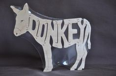 Donkey Animal Puzzle Wooden Toy Hand  Cut with Scroll Saw by Puzzimals on Etsy https://www.etsy.com/uk/listing/62495816/donkey-animal-puzzle-wooden-toy-hand-cut
