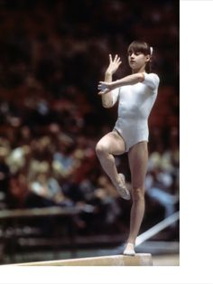 Romania Nadia Comaneci in action on balance beam during Women's competition at Madison Square Garden. Artistic Gymnastics World Cup. Jerry Cooke ) Get premium, high resolution news photos at Getty Images Gymnastics World, Artistic Gymnastics, Gymnastics Posters, Nadia Comaneci Perfect 10, Life In Usa, Romanian Girls, Gymnastics Pictures, Balance Beam, Female Stars