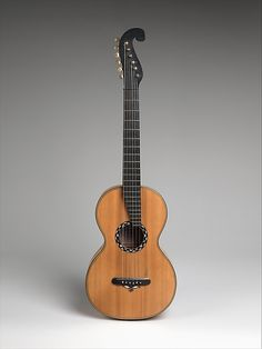 "1838 American (New York) Guitar at the Metropolitan Museum of Art, New York - From the curators' comments: ""This guitar has a one-piece back and sides of bird's-eye maple; the top is spruce. Like the Stauffer guitar, the neck angle can be adjusted with a key mechanism."""