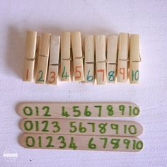 write numbers on craft sticks or paint sticks and clothes pin with sharpies