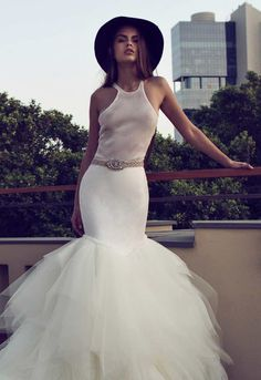 """Whether you want a wedding dressthat's royal-wedding worthy, ultra seductive, or something in between, today's top picked wedding gowns has an range of designs that brides can play around with. Embellished bodices, lacytops, and romanticluxurious fabrics, these dresses are stylish, classy, and take the word """"creativity"""" to a whole other level."""
