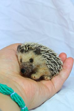 Needle felted hedgehog, miniature. $60.00, via Etsy. (Perfect quills! Love it!)