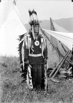 Flathead Indian called Flathead taken in 1905 with full regalia of feathers and beadwork