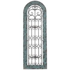 """Add an artful finishing touch to your den, dining room, or master suite with this nature-inspired design, beautiful as a chic statement piece or composed as an imaginative vignette.  Product: Wall décor Construction Material: MetalColor: Distressed blueDimensions: 44"""" H x 15"""" W"""