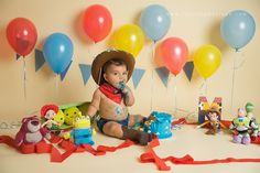 Look at him! This Toy Story themed cake smash first birthday session is too sweet!