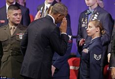 Salute! The president offered respect to a female airman after his speech, but he got little respect from thousands of men and women Legion members in Charlotte. Odd salute too.