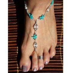 This stunning set of barefoot sandals are the perfect way to dress up your bare feet for your big day. Vibrant Caribbean blue starfish with white, freshwater pearls, glass and silver plated beads, harmonize perfectly to make this the perfect beach wedding accessory.  All foot jewelry sold in pairs.