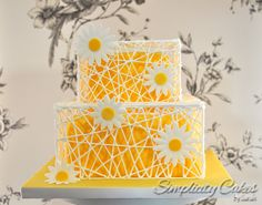 Yellow sunflower cake - delicate royal icing 'cage' around a bright yellow coloured cake decorated with sugar sunflowers| Simplicity Cakes by Sarah
