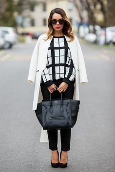 High contrast. White coat paired with a linear, black and white top.