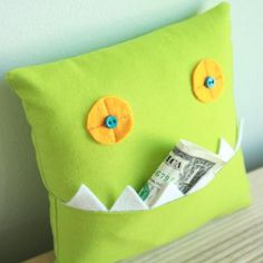 tooth fairy pillow - could be a bed pillow that holds a book for bed time reading....use fabric swatches from designers.