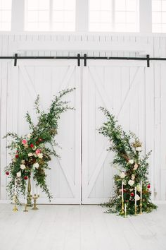 Lush floral ceremony installation for a white barn wedding. Incredible surprise proposal at The White Sparrow Barn in Texas. Planning and Design by Ivory & Vine Event Co.