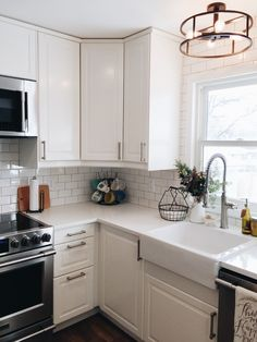 I& so excited to finally share our kitchen tour! We renovated June to August and it was a huge project. I found out I was pregnant the we. Small L Shaped Kitchens, L Shaped Kitchen Designs, U Shaped Kitchen, Small Farmhouse Kitchen, Small Apartment Kitchen, Kitchen On A Budget, Updated Kitchen, New Kitchen, Kitchen Dining