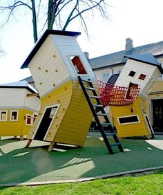 Brumleby Playground, Copenhagen  This topsy-turvy playground's centerpiece consists of three warped houses connected by balancing bridges and equipped with climbing grips on the walls and slides from the windows. For fans of traditional parks, Brumleby also has roll overbars, seesaws and swings.  Photo courtesy of Monstrum