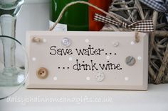 Handmade plaque decorated with buttons.  Sign reads 'Save water...drink wine' from www.daisychainhomeandgifts.co.uk