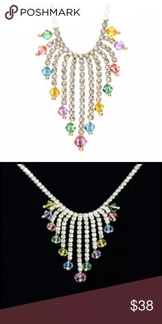 "DF100 Swarovski Crystal Pastel Waterfall Necklace ‼️PRICE FIRM‼️   Swarovski Crystal Necklace  Retail $130  To say that this is a spectacular necklace would be an understatement. Beautifully & skillfully handcrafted from the finest Swarovski crystals with a 14K gold overlay. Necklace is approximately 17"". Crystal waterfall section is approximately 1.25"" by 1.5"""".  Please check my closet for many more items including designer clothing, scarves and much more. Handmade Jewelry Necklaces"