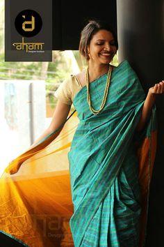 Green saree and cream blouse