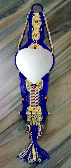 http://emurli.com/wp-content/uploads/2014/01/1374748403_524577823_1-Pictures-of-Macrame-decorative-mirror.jpg