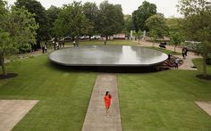 Guardian Picture desk live: Press Preview Of The Serpentine Gallery Pavilion 2012  This year's Serpentine gallery pavilion has been unveiled to the press in Hyde Park. The pavilion, designed by Herzog & de Meuron and Ai Weiwei, is the twelfth in the gallery's annual architectural commission – and a passerby in contrasting outfit conveniently sets the scene