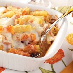 Cheesy Rigatoni Bake Recipe -This baked pasta is a family favorite. One of our four children always asks for it as a birthday dinner. —Nancy Urbine, Lancaster, Ohio