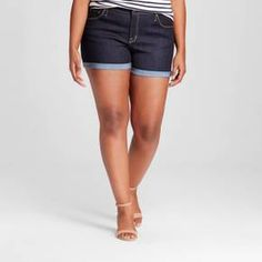 Jean shorts are a summer wardrobe staple and the Women's Plus Size Denim Midi Short Dark Wash - Ava & Viv™ are exactly what you've been looking for. You'll wear these plus size women's shorts all summer long. The perfect match for all your favorite summer tees, tops and blouses.