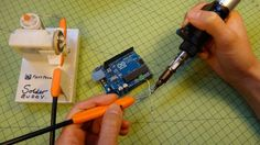"""Solder Buddy: """"A humble contraption made from a old broken bike brake cable, a servo (with locking-pin removed) and of course some Sugru! Arduino, Sugru, Electrical Projects, Diy Electronics, Soldering, Design Model, How To Remove, Diy Projects, Crafty"""