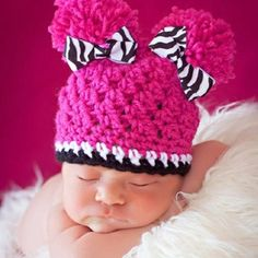 Come on- who can resist a baby with pom- poms  crochet baby pom pom hat  from etsy b5dac9a8481