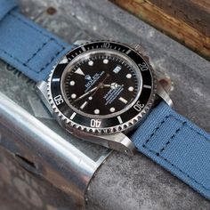 Barton Watch Bands quick release blue canvas strap on a Rolex Sea Dweller watch.