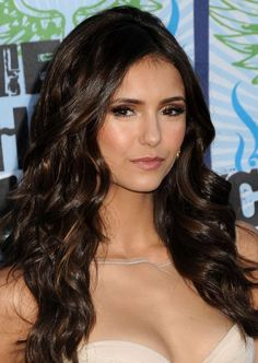 The Vampire Diaries star Nina Dobrev's layered long chocolate brown hair with caramel highlights.