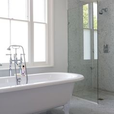 Soft grey marble bathroom.  Opaque film on glass to let the light though... to prevent us from looking into S's bedroom!