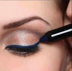 champagne shadow w/ bold navy liner on top lashline  <3