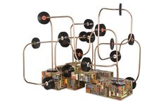 """A large installation sculpture inspired by toy abacus mazes.  Materials: wood, book spines, upholstery nails, conduit, vinyl records    108""""w x 87""""d x 84""""h"""