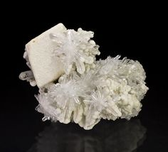 White rhombohedral Calcite crystal set on a matrix of crystallized Quartz and minor Calcite