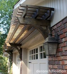 garage pergola & lights on sides. Could look good over a certain front door! ...or back!