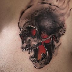 I love skull tattoos with color behind them. It makes them look 3D.