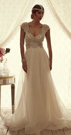 Vintage-inspired bohemian peal-beaded scoop neck wedding dress; Featured Dress: Anna Campbell