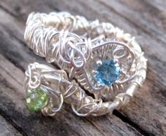 """Hand-Formed Adjustable Ring    Materials: Swiss Blue Topaz Set in Sterling Silver and Swarovski Crystal """"Entwined"""" with Silver Plated Wire."""