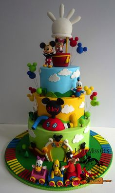 three tier cake, mickey mouse cake ideas, covered with blue yellow and green fondant, disney characters decorations Cake Pops Mickey Mouse, Minnie Y Mickey Mouse, Mickey Mouse First Birthday, Mickey Mouse Baby Shower, Mickey Mouse Clubhouse Birthday Party, Mickey Cakes, Mickey Mouse Cake Decorations, 2nd Birthday, Birthday Ideas